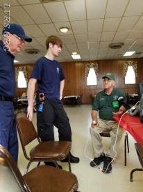 Tyler taking Mr. Morgan's blood pressure