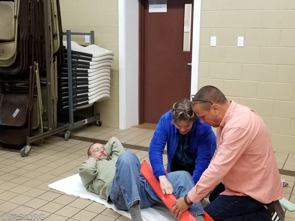 Robert being splinted by Mary Ellen and Tony. Robert felt so much better afterward.
